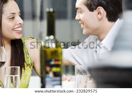 Happy Couple at Dining Table - stock photo