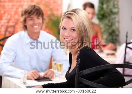 happy couple at restaurant - stock photo