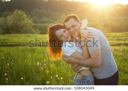 happy couple at sunset