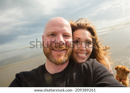 happy couple at the beach - stock photo