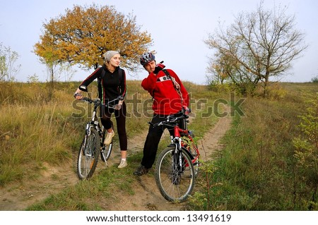 Happy couple at the cycling walk - stock photo