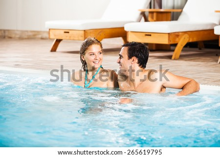 Happy couple at the swimming pool
