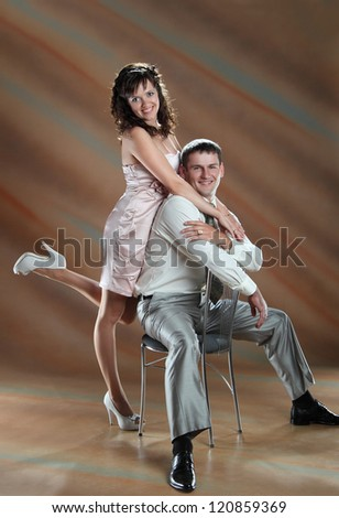 happy couple at the wedding on brown background - stock photo