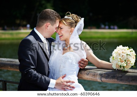Happy couple bride and groom at a wedding walk - stock photo