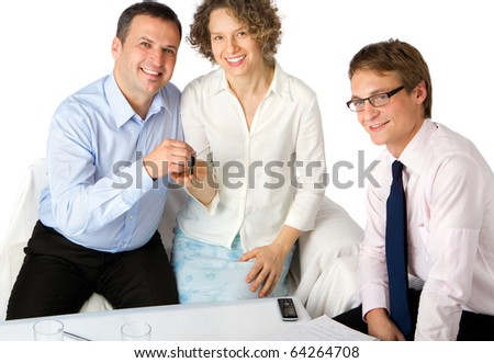 Happy couple buying new home with real estate agent - stock photo
