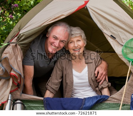 Happy couple camping in the garden - stock photo
