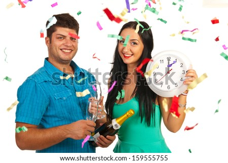 Happy couple celebrate new year party with champagne and confetti - stock photo