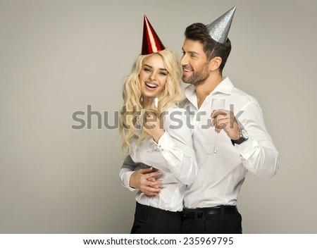 Happy couple celebrating new year with glasses of the champagne - stock photo