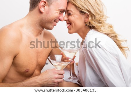 Happy couple celebrating with glass of champagne  - stock photo