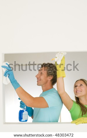 happy couple cleaning at home