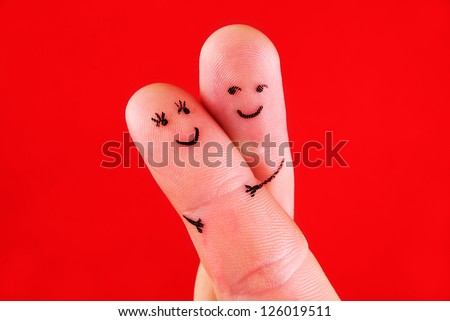 happy couple concept - a man and a woman hug,painted at fingers isolated on red background - stock photo