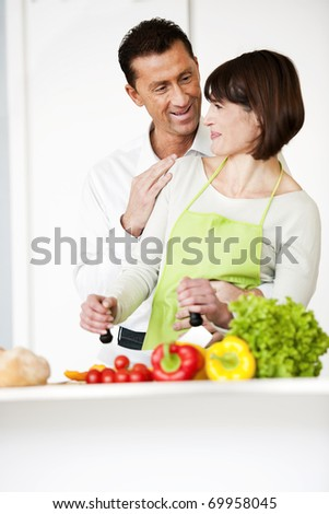 Happy Couple Cooking Together - stock photo