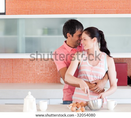 Happy couple cooking together at home - stock photo