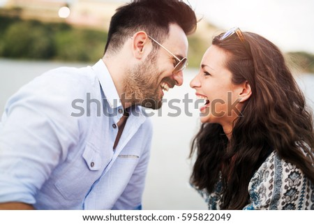 Happy couple dating and happily flirting outdoor
