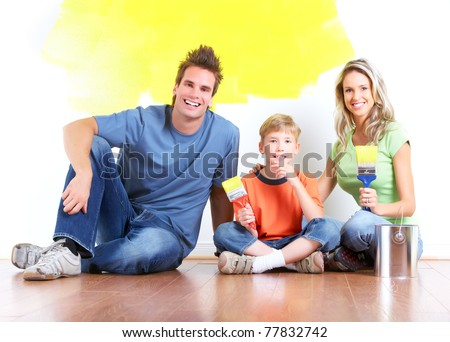 Happy couple doing renovation at home. House decoration. - stock photo