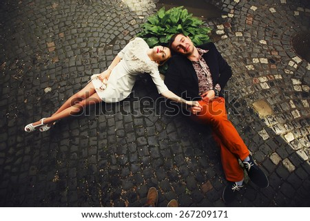 happy couple dreaming together holding hands - stock photo