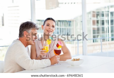 Happy couple drinking a glass in a bar - stock photo