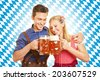 Happy couple drinking beer at Oktoberfest in Bavaria - stock photo