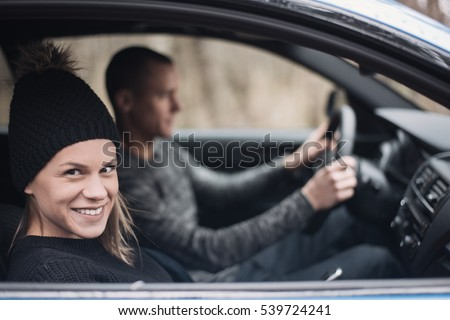 Happy Couple Driving a car. Freedom of the open road.