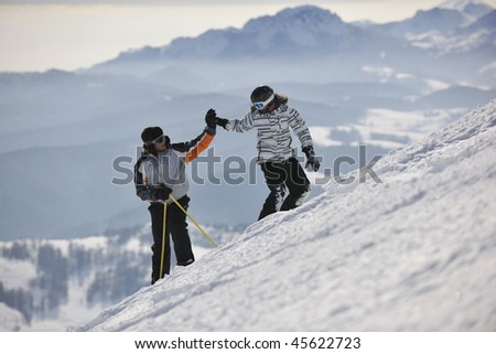 happy couple driving and relaxing with snowboard and ski at winter seasson on mountain - stock photo