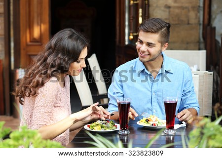 happy couple eating at terrace - stock photo