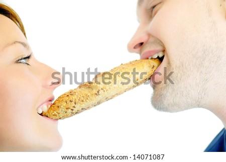 happy couple eating croissant - stock photo