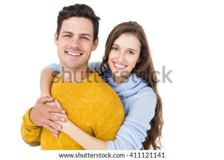 Happy couple embracing and looking camera on white background - stock photo