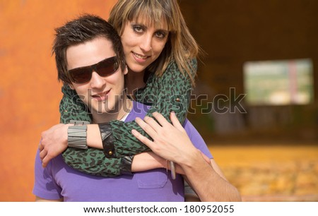 Happy couple embracing outdoors a building in ruins - stock photo