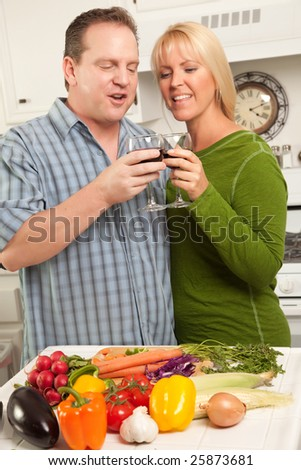Happy Couple Enjoying An Evening Preparing Food in the Kitchen.
