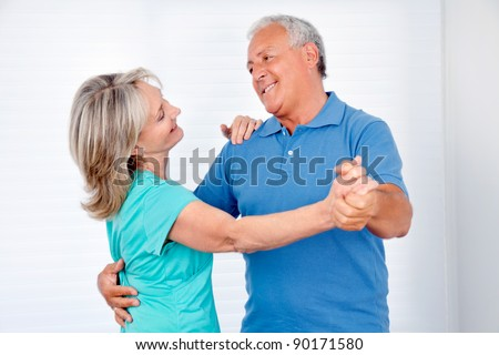 Happy couple enjoying dance together at home - stock photo