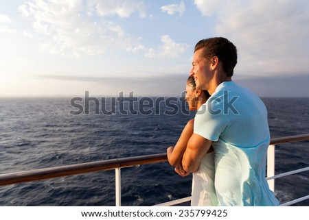 happy couple enjoying sea view in the morning on a cruise ship - stock photo