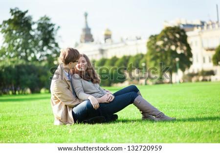 Happy couple enjoying sunny day together - stock photo