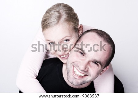 Happy couple - focus on the girl. - stock photo