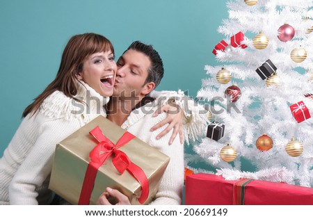happy couple gift on christmas eve - stock photo
