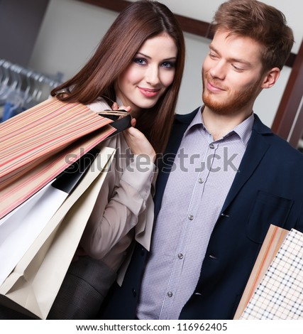 Happy couple goes shopping - stock photo
