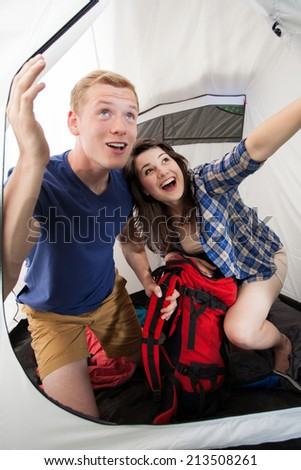 Happy couple going outside the tent