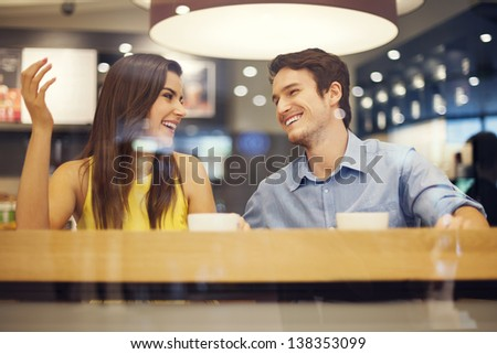 Happy couple have fun in cafe - stock photo