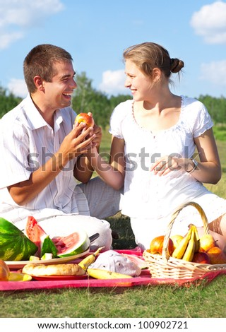 happy couple have picnic outdoor