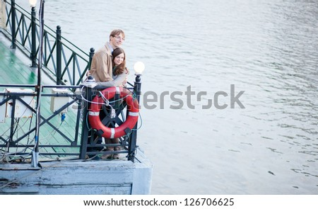 Happy couple having a date and hugging - stock photo