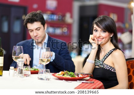 Happy couple having dinner in a luxury restaurant - stock photo