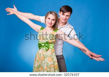 Happy couple having fun in studio - stock photo