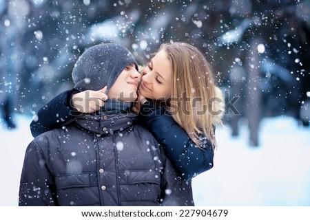 Happy Couple Having Fun Outdoors. Snow. Winter Vacation. Outdoor - stock photo