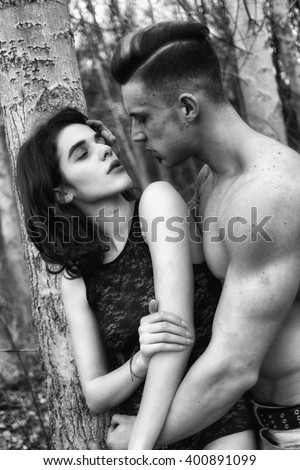 Happy couple having great time together. Attractive sexy woman leaning on the bare chest of attractive young brunette man. Fashion photo.