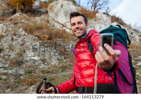 happy couple hiking with backpacs and sticks in mountains stock photo. Black Bedroom Furniture Sets. Home Design Ideas