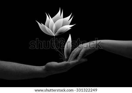 Happy couple holding hands with white flower.Two hands (helping hand to a friend) - stock photo
