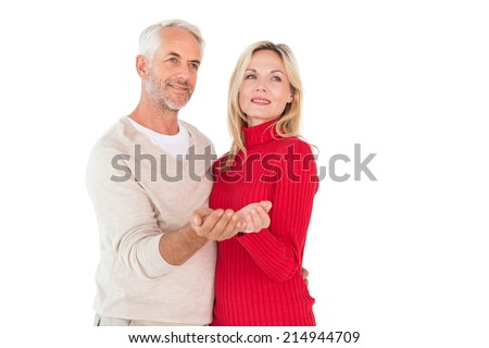 Happy couple holding their hands out on white background