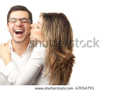 Happy couple hugging and kissing over white background - stock photo