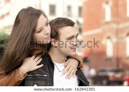 Happy couple hugging and looking at the city - stock photo