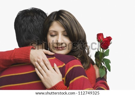Happy couple hugging each other - stock photo