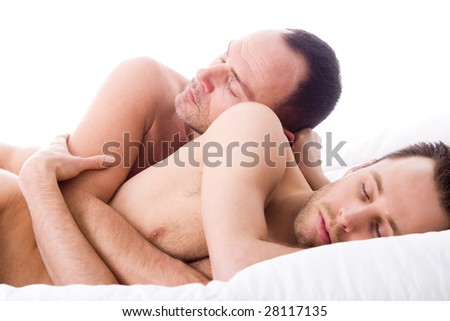 Happy couple in a white bed - stock photo